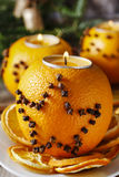 Orange pomander ball with candle. Christmas decor Royalty Free Stock Images