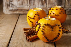 Orange pomander ball with candle Royalty Free Stock Images