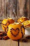Orange pomander ball with candle, christmas decoration Stock Photo
