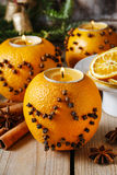 Orange pomander ball with candle, christmas decoration Royalty Free Stock Photos