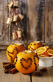 Orange pomander ball with candle decorated with cloves in heart Royalty Free Stock Photo