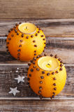 Orange pomander ball with candle, Royalty Free Stock Images