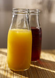 Orange and pomegranate juice in a jar mug Royalty Free Stock Photography