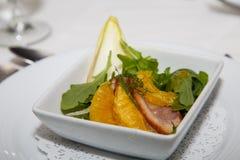 Orange and Pork Appetizer Stock Image
