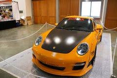 Orange Porsche car on display at Auto Show Royalty Free Stock Image
