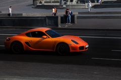 Orange Porsche 911 in city Royalty Free Stock Photography
