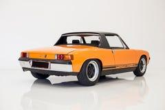 Orange Porsche 914 studio white stock images