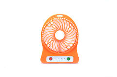 Orange portable mini electric fan on isolated white background. Orange, portable, battery powered, rechargeable, small, mini electric fan, cheap and affordable Royalty Free Stock Images