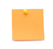 Orange post-it with drawing pin Stock Photo