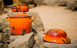 Orange pots and pans Royalty Free Stock Photography