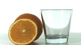 Orange pouring into glass stock video