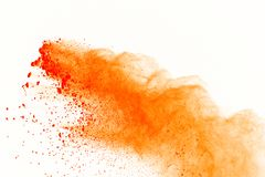 Orange powder explosion isolated on white background. Abstract o. F colored dust explosive royalty free stock photography