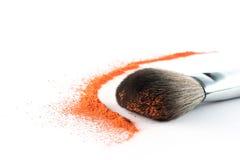 Orange Powder Eyeshadow on a Brush, fashion beauty Royalty Free Stock Images