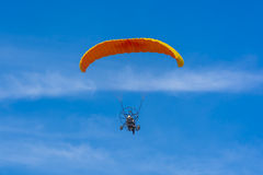Orange powered tandem para glider flying Stock Photo