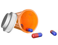 Orange Prescription Medicine Bottle Pills Capsules. An open prescription medicine bottle on its side and spilled, with blue and red capsules or pills and Royalty Free Stock Photography