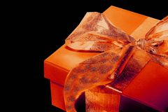 Orange Present. Isolated on Black Royalty Free Stock Images