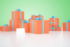 Orange present boxes on green Royalty Free Stock Photos