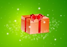 Orange present with red ribbon Royalty Free Stock Image