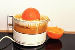 Orange Presse und Saft Lizenzfreie Stockfotografie
