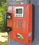 Orange Public Phone Stock Photo