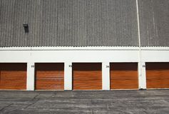 Orange public storage gates. / facility for rent stock photography