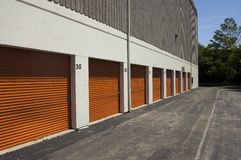 Orange public storage gates. / facility for rent stock image