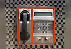 Orange public telephone Royalty Free Stock Photos