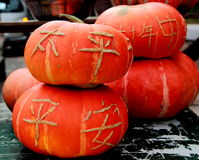 Orange pumpkin. Some big pumpkin isolated and the meaning of the chinese words carved are uneventfully and safety royalty free stock photography