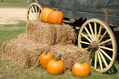Orange Pumpkin on Brown Hay Near Gray Carriage Stock Photo