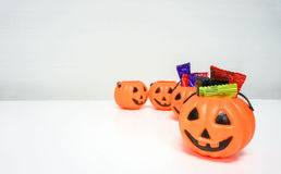 Orange pumpkin with colorful candies for Halloween. Party Royalty Free Stock Photography
