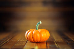Orange pumpkin on dark wooden royalty free stock images