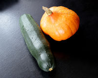 Orange pumpkin and green squash vegetable marrow Royalty Free Stock Photos
