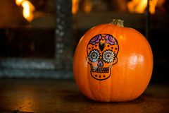 Halloween pumpkin skull drawing dark background. Orange pumpkin horeca design copy space stock images