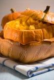 Orange pumpkin pan. Pumpkin made pan with pieces of pulp Stock Image