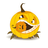 Orange pumpkin with white teeth and a squint, eating a small pum Royalty Free Stock Photo