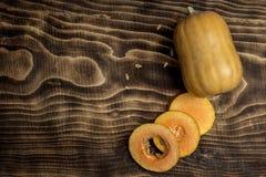 Orange pumpkin, wooden background Stock Images