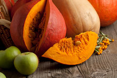 Orange pumpkins and apples Royalty Free Stock Image