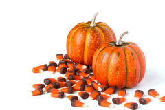 Orange Pumpkins and Candy Corn Decorations. Two orange pumpkins and candy corn on a white background. Space is left for wording stock photography