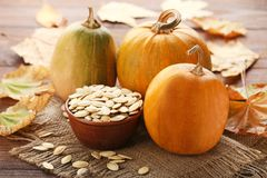 Pumpkins with leafs and seeds Royalty Free Stock Photography