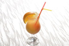 Orange punch. Tropical drink in a hurricane glass with orange slice Royalty Free Stock Photography