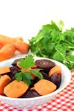 Orange and purple carrots with green parsley Stock Images