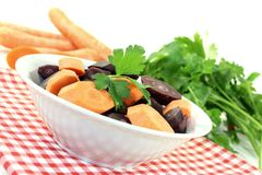 Orange and purple carrots with parsley Stock Photos