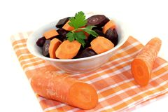 Orange and purple carrots with smooth parsley Stock Image