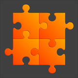 Orange Puzzle Pieces. Four interlocked jigsaw puzzle pieces on black Royalty Free Stock Image