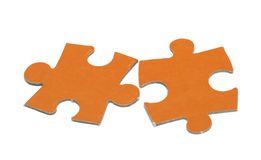 Orange puzzle are on a white background Royalty Free Stock Photography