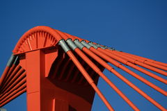 Orange pylon of bridge Stock Photography