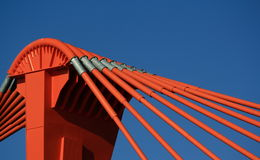Orange pylon of bridge Stock Photos