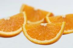 Orange quarters. Four fresh cut orange quarters Royalty Free Stock Image