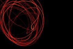 Orange röd energibakgrund för orange virvel Arkivfoto