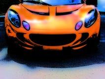 Orange Race Car Grunge. A grunge design of an orange sporty race car Stock Image